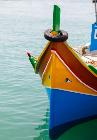 Luzzu, traditional eyed fishing boats, Marsaxlokk, Malta photo