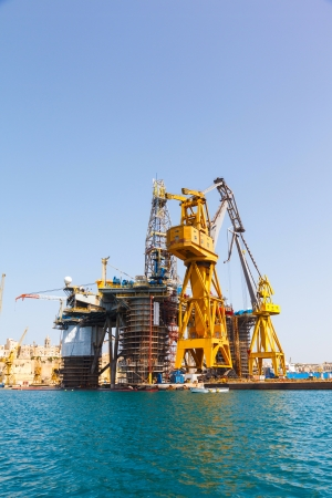 Oil platform repair Shipyards harbor of Malta in clear weather on a background of blue sky photo