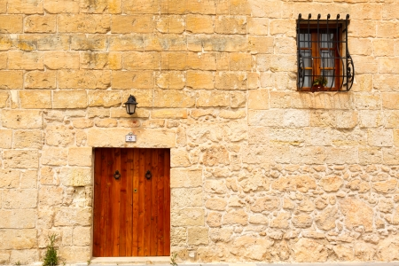 old wooden front door and window to the house in the Mediterranean photo