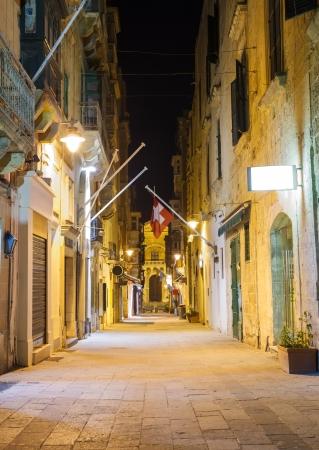 narrow old street in Valletta in a warm summer night