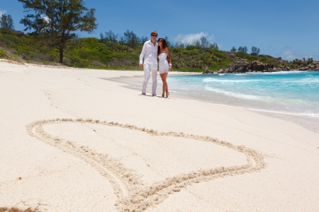 Young couple married on sandy beautiful tropical beach Seychelles La Digue photo