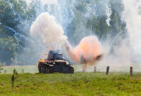 WW2 German Panzer 38 (t) light tank, and the explosion of a shell hit Editorial