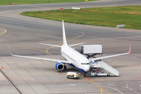 loading and unloading of containers in the cargo aircraft with platform photo