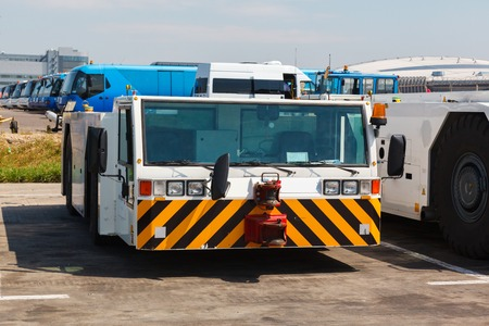 best travel destinations: airport tug tractor on the airport on the airfield Stock Photo