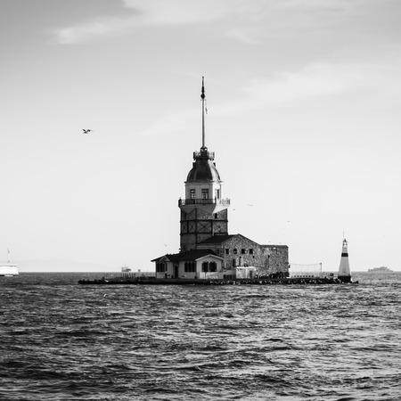 The Maiden's Tower in istanbul, Turkey on background blue sky photo