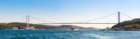 waterside: bridge on Bosphorus connecting the european waterside of Istanbul with the asian waterside on background of blue sky
