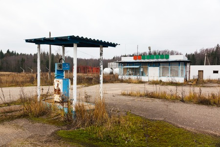 abandoned gas station: rusty abandoned pump on the gas station at autumn day in Russia