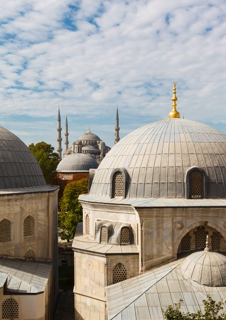 Tomb of Sultan Selim II, Murad III and Blue Mosque on background the blue sky on clear day, Istanbul, Turkey photo