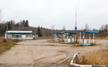 abandoned gas station: abandoned gas station and rusty pump at autumn day in Russia