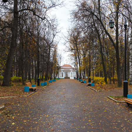 the rotunda: Autumn alley with lanterns and rotunda in the park. Russia