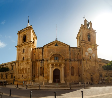 St. Johns Co-Cathedral on background blue sky in Valletta, Malta Stock Photo