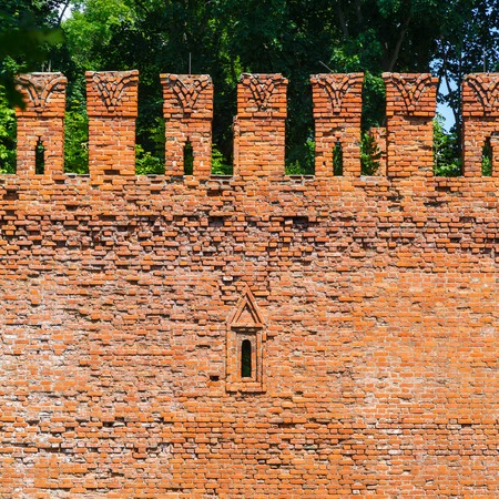 embrasure: Embrasure in the defense wall of red bricks of ancient city Smolensk
