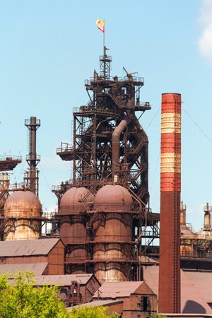 steelworks: building a blast furnace at the steel industry on a background of blue sky