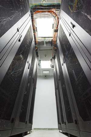 rack server: racks in the data center and the corridor between them Stock Photo