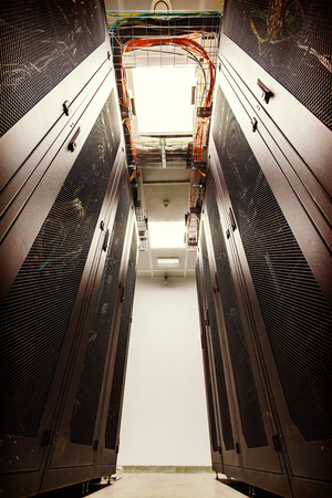 racks in the data center and the corridor between them photo