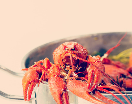 weenie: Boiled crayfish in pan on a wooden board, a traditional Russian dish Stock Photo