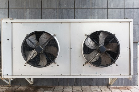 chiller: industrial air conditioner outdoor unit with two fans closeup