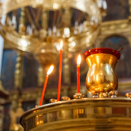 messa: Candles in christian church. Pskov west Russia