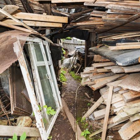 slums: passage in the slums, wood waste and debris, Russia