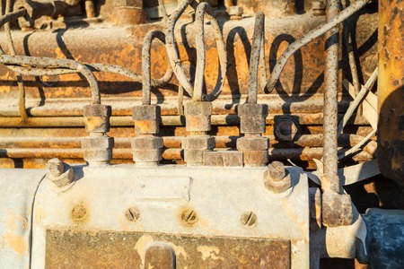 horse pipes: Old rusty vintage diesel engine parts closeup