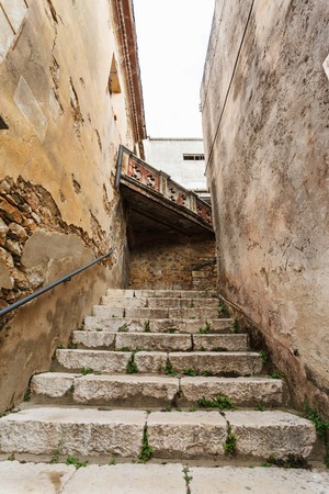 the narrow streets of the mountain town of Baunei in Italy, Sardinia photo
