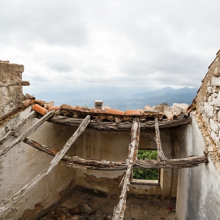 ruins house on background of sky in the mountain town Baunei in Italy, Sardinia photo