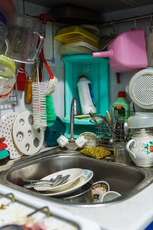 mess: Pile of dirty dishes in sink and counter top, mess in the kitchen