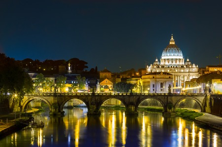 st  peter s  basilica: Night landscape of Rome, Angels bridge and St. Peter s basilica near river Tiber Stock Photo