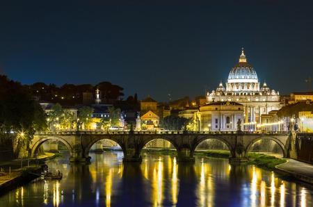 st peter s basilica: Night landscape of Rome, Angels bridge and St. Peter s basilica near river Tiber Stock Photo