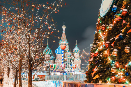 Decorations for New Year and holidays. Christmas balls on tree branches near to St. Basils Cathedral on Red square in Moscow