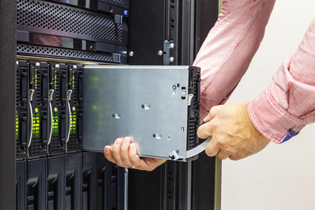replacement of faulty blade server in chassis, the platform virtualization in the data center server rack Stock Photo