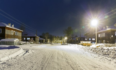 barracks: old wooden barracks at winter night in remote villages of Russia