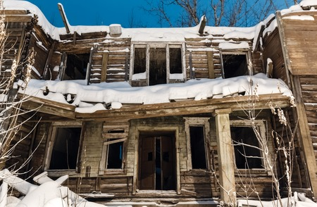 barracks: old wooden ruined barracks at winter night in remote villages of Russia
