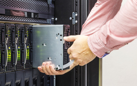 computer security: replacement of faulty blade server in chassis, the platform virtualization in the data center server rack Stock Photo