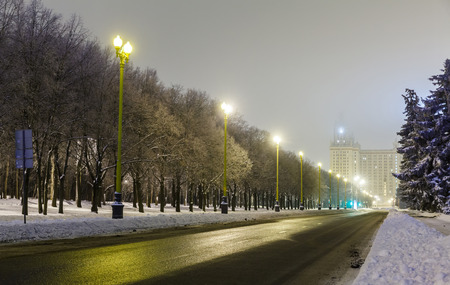 Winter street in the light of the lamps and fog, The University of Moscow in the winter photo