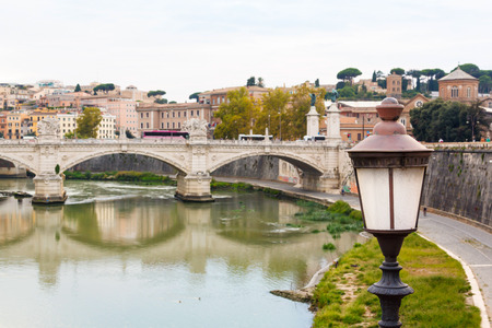 st  peter s  basilica: old lantern and bridge and St. Peter s basilica near river Tiber. Rome, Italy