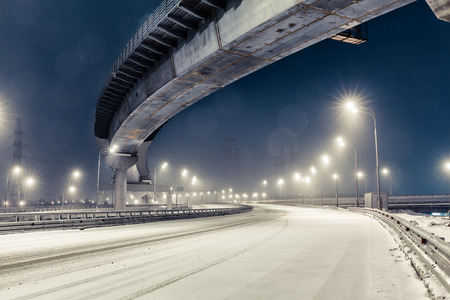 city street: transport metropolis, traffic and blurry lights of cars on multi-lane highways and  road junction at night in Moscow