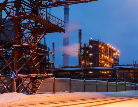 smokestacks: many pipes and smokestacks with industrial tower of metal on the chemical industry at night Stock Photo