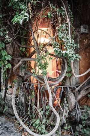 curlicue: old streets of Italy, the window in an old house covered with curlicue wood Stock Photo