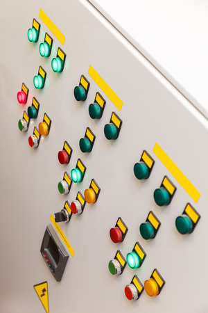 electrical panel: White electrical panel with multi colored indicators Stock Photo