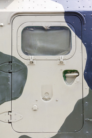 coloration: armored door in a military vehicle in a protective coloration