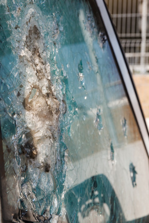 bulletproof: bulletproof glass car after the shooting with traces of bullets