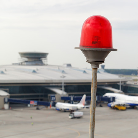 obstruction: red flashing lights on the roof on a background of the airport Stock Photo