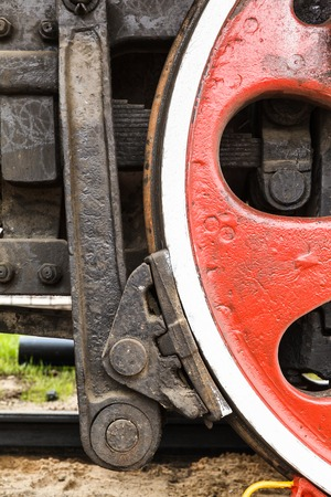 heavy heart: wheel detail of a vintage russiam steam train locomotive