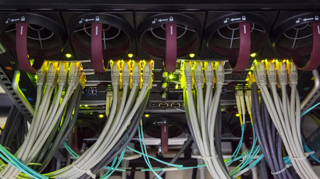 utp: rack in the data center with working servers with optical FC and UTP cables