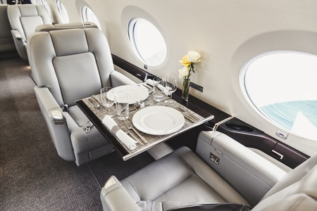 corporate jet: Luxury interior in bright colors of genuine leather in the aircraft business aviation