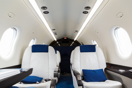 private airplane: Luxury interior in bright colors of genuine leather in the aircraft business aviation