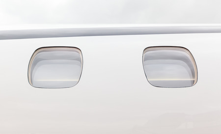 aircraft rivets: white fuselage and porthole outside the aircraft