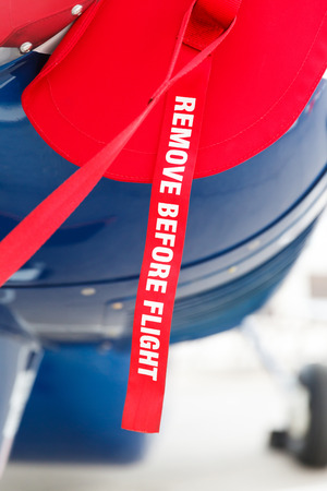 private parts: Aviation detail, ribbon remove before flight on the aircraft fuselage