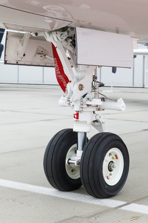private parts: front landing gear and ladder in light business aircraft on the ground